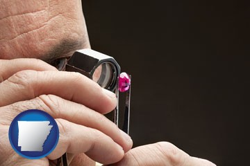a jeweler examining a jewel - with Arkansas icon