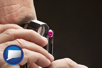 a jeweler examining a jewel - with Connecticut icon