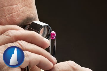 a jeweler examining a jewel - with New Hampshire icon