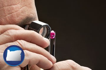 a jeweler examining a jewel - with Oregon icon