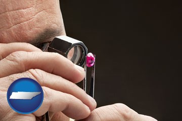 a jeweler examining a jewel - with Tennessee icon